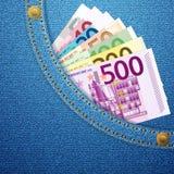 牛仔布口袋和欧洲钞票 库存照片