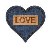 牛仔布和皮革心脏 库存图片