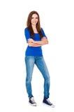 牛仔布牛仔裤的美丽的十几岁的女孩在白色 库存照片