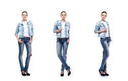 牛仔布牛仔裤的美丽的十几岁的女孩在白色 库存图片