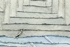 牛仔布织品里面样式补缀品纹理  免版税库存图片