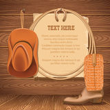 牛仔帽和美国套索 文本的传染媒介老纸在木头 免版税图库摄影