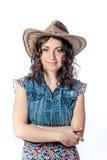 牛仔帽的微笑的女孩 免版税库存照片