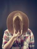 牛仔帽马乘驾使用 图库摄影