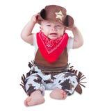 牛仔成套装备的哭泣的婴孩 库存照片