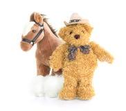 牛仔玩具熊和马 图库摄影