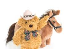 牛仔玩具熊和马 免版税库存图片