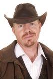 牛仔皮革外套帽子假笑关闭 图库摄影