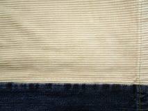 牛仔裤和条绒 库存照片