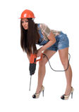 牛仔裤巫婆电锤钻子的少妇 查出 图库摄影