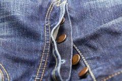 牛仔裤按钮 免版税库存照片