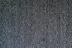 黑牛仔裤织品纹理背景 免版税库存照片