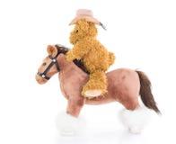 牛仔骑马的玩具熊 库存照片