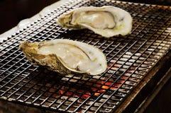 牡蛎烘烤 库存图片