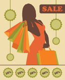 购物与销售贴纸的妇女剪影 免版税图库摄影