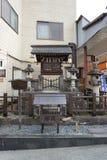 购物中心木头和石头祀奉在Miyagawa早晨市场上  免版税库存图片