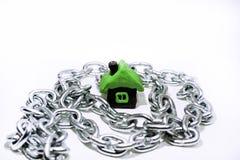 物产和信用抽象想法  物产,房子,金钱的问题 免版税库存图片