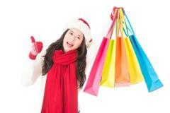 物品的圣诞节销售妇女愉快的购物赞许 库存照片