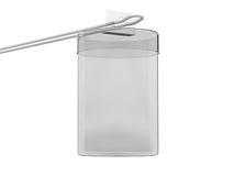 物品的透明圆柱形箱子在勾子 免版税库存图片