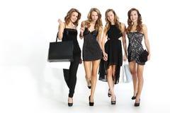 购物在精品店的妇女 免版税库存照片