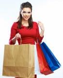 购物妇女举行袋子,被隔绝的画象 奶油被装载的饼干 免版税库存照片