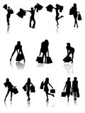 购物家庭和女孩剪影。 免版税库存图片