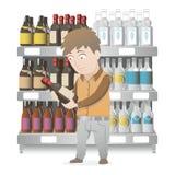 购物的男孩一个瓶酒 免版税图库摄影