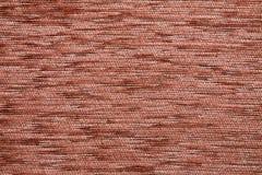 织物纹理Kombin橙红色颜色 免版税库存照片