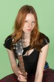 特写镜头吉他题头球员红色岩石卷 库存照片