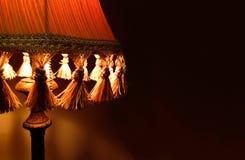 特写镜头在床头柜内部室的织品灯 免版税库存图片