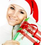 特写镜头女孩纵向俏丽的圣诞老人 免版税库存图片
