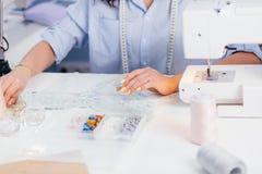 特写镜头播种了装饰与小珠的织品照片  图库摄影