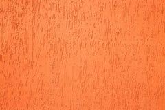 特写镜头淡色橙色混凝土墙纹理背景 免版税库存照片
