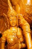 特写镜头淡黄色蜡烛雕象夫人天使,一在泰国` s每年佛教传统节日游行的雕塑  免版税库存照片