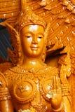 特写镜头淡黄色蜡烛雕象夫人天使,一在泰国` s每年佛教传统节日游行的雕塑  图库摄影