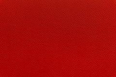 特写镜头红色皮革纹理或背景 免版税库存照片