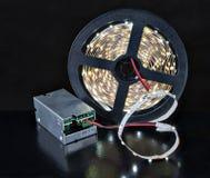 特写镜头亮光LED在短管轴和电压适配器的光磁带 库存照片