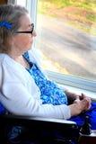 特写镜头坐由窗口的Handycapped妇女 免版税图库摄影