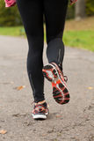 特写镜头妇女跑步 库存照片