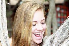 特写镜头微笑的青少年的女孩 库存照片