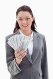 特写镜头拿着很多美元的女实业家 免版税库存图片