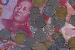 特写镜头被射击瓷钞票和硬币 库存照片