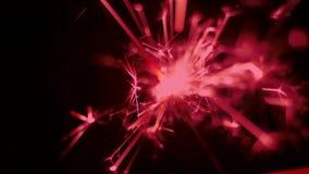 特写镜头被射击红颜色闪烁发光物 假日或庆祝事件 Colorized射击 股票录像