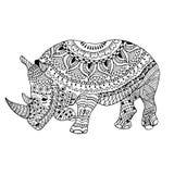 犀牛乱画传统化了,手拉,黑在白色 库存照片