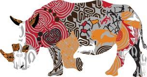 一头犀牛的剪影在种族样式的 免版税库存照片