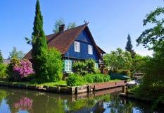 狂欢水的森林房子 库存照片