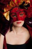 狂欢节屏蔽红色佩带的妇女 免版税图库摄影