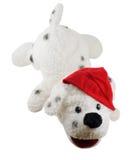 狗帽子圣诞老人被充塞的玩具 免版税库存照片