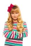 狡猾的白肤金发的女孩 免版税库存照片