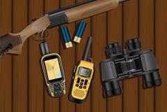 狩猎步枪,弹药筒,导航员,携带无线电话 免版税图库摄影